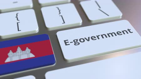 cambojano : E-government or Electronic Government text and flag of Cambodia on the keyboard. Modern public services related conceptual 3D animation Vídeos