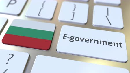 búlgaro : E-government or Electronic Government text and flag of Bulgaria on the keyboard. Modern public services related conceptual 3D animation