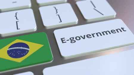 brazilian : E-government or Electronic Government text and flag of Brazil on the keyboard. Modern public services related conceptual 3D animation Stock Footage