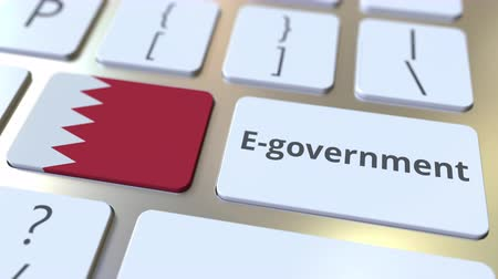 empregos : E-government or Electronic Government text and flag of Bahrain on the keyboard. Modern public services related conceptual 3D animation