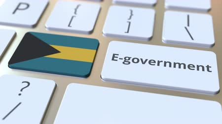 involvement : E-government or Electronic Government text and flag of the Bahamas on the keyboard. Modern public services related conceptual 3D animation
