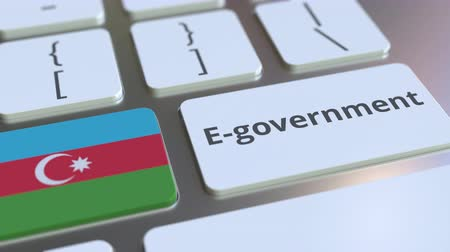 empregos : E-government or Electronic Government text and flag of Azerbaijan on the keyboard. Modern public services related conceptual 3D animation