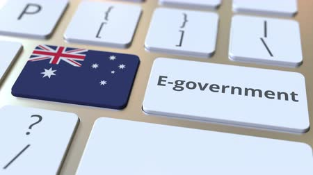 involvement : E-government or Electronic Government text and flag of Australia on the keyboard. Modern public services related conceptual 3D animation Stock Footage
