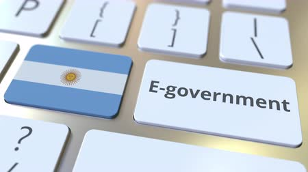 involvement : E-government or Electronic Government text and flag of Argentina on the keyboard. Modern public services related conceptual 3D animation