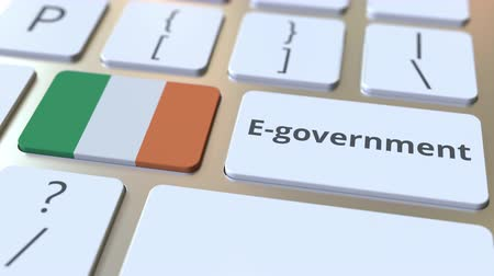 involvement : E-government or Electronic Government text and flag of the Republic of Ireland on the keyboard. Modern public services related conceptual 3D animation Stock Footage