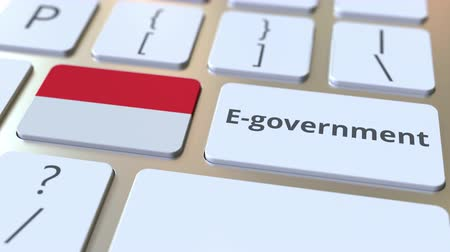 involvement : E-government or Electronic Government text and flag of Indonesia on the keyboard. Modern public services related conceptual 3D animation