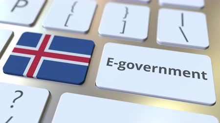 involvement : E-government or Electronic Government text and flag of Iceland on the keyboard. Modern public services related conceptual 3D animation Stock Footage