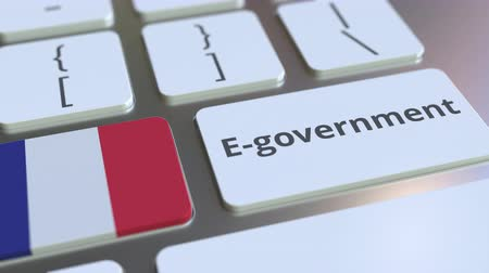 involvement : E-government or Electronic Government text and flag of France on the keyboard. Modern public services related conceptual 3D animation Stock Footage