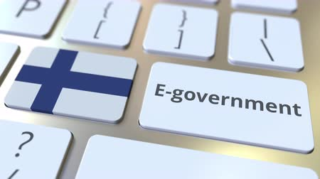 fince : E-government or Electronic Government text and flag of Finland on the keyboard. Modern public services related conceptual 3D animation