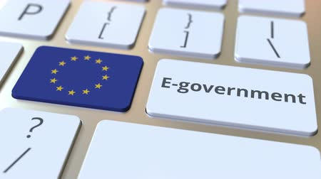 involvement : E-government or Electronic Government text and flag of the European Union on the keyboard. Modern public services related conceptual 3D animation Stock Footage
