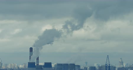 residencial : Red camera time lapse of polluting smoking stacks on a depressive urban background