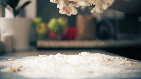 damlatma : Dropping bread dough on flour, slow motion close-up shot