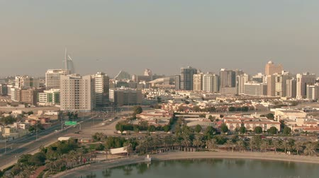 отель : Aerial shot of Dubais seafront area near Al Barsha Pond Park. UAE