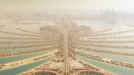отель : High altitude aerial view of the Palm Jumeirah island and Dubais skyline. UAE