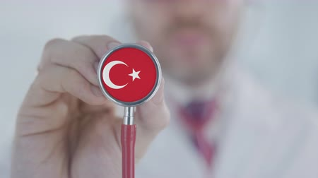 diagnóstico : Doctor uses stethoscope with the Turkish flag. Healthcare in Turkey Stock Footage