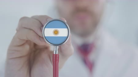 diagnóstico : Doctor uses stethoscope with the Argentinean flag. Healthcare in Argentina