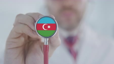 diagnóstico : Doctor holds stethoscope bell with the Azerbaijani flag. Healthcare in Azerbaijan