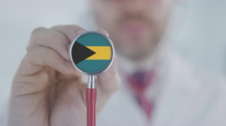 diagnóstico : Physician uses stethoscope with the Bahamian flag. Healthcare in the Bahamas