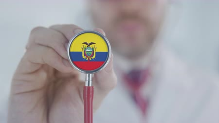 diagnóstico : Physician listening with the stethoscope with flag of Ecuador. Ecuadorian healthcare