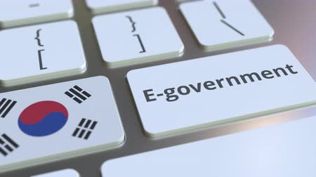 юг : E-government or Electronic Government text and flag of South Korea on the keyboard. Modern public services related conceptual 3D animation