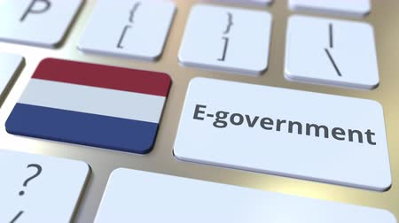 involvement : E-government or Electronic Government text and flag of the Netherlands on the keyboard. Modern public services related conceptual 3D animation