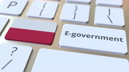 involvement : E-government or Electronic Government text and flag of Poland on the keyboard. Modern public services related conceptual 3D animation
