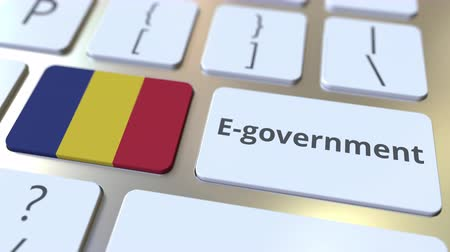 romeno : E-government or Electronic Government text and flag of Romania on the keyboard. Modern public services related conceptual 3D animation Stock Footage