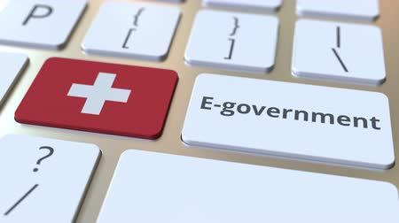 involvement : E-government or Electronic Government text and flag of Switzerland on the keyboard. Modern public services related conceptual 3D animation