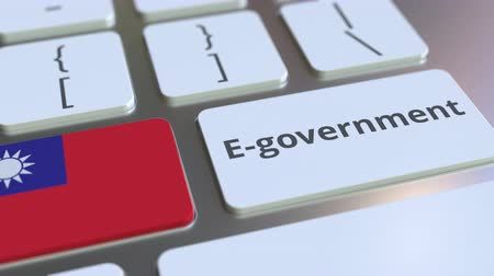 it : E-government or Electronic Government text and flag of Taiwan on the keyboard. Modern public services related conceptual 3D animation