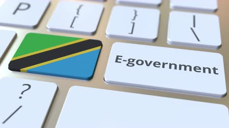 involvement : E-government or Electronic Government text and flag of Tanzania on the keyboard. Modern public services related conceptual 3D animation
