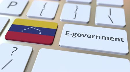 involvement : E-government or Electronic Government text and flag of Venezuela on the keyboard. Modern public services related conceptual 3D animation