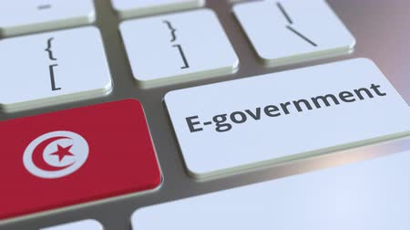 involvement : E-government or Electronic Government text and flag of Tunisia on the keyboard. Modern public services related conceptual 3D animation Stock Footage