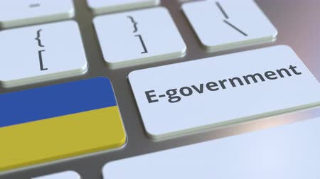 involvement : E-government or Electronic Government text and flag of Ukraine on the keyboard. Modern public services related conceptual 3D animation