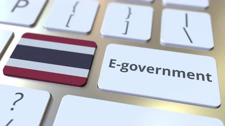 involvement : E-government or Electronic Government text and flag of Thailand on the keyboard. Modern public services related conceptual 3D animation