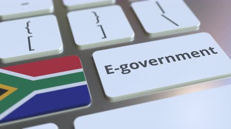 equipos electronicos : E-government or Electronic Government text and flag of South Africa on the keyboard. Modern public services related conceptual 3D animation