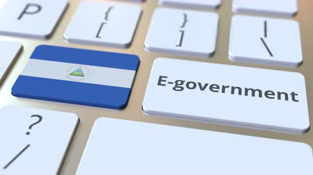 nicaraguan : E-government or Electronic Government text and flag of Nicaragua on the keyboard. Modern public services related conceptual 3D animation