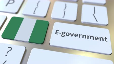 involvement : E-government or Electronic Government text and flag of Nigeria on the keyboard. Modern public services related conceptual 3D animation