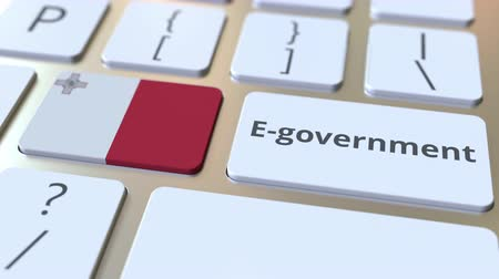 kutya : E-government or Electronic Government text and flag of Malta on the keyboard. Modern public services related conceptual 3D animation