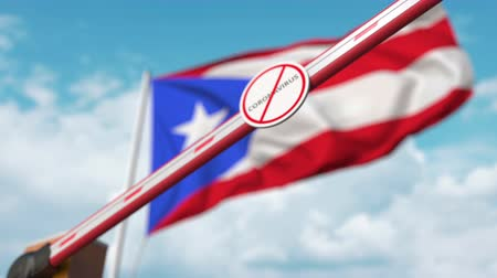 щит : Closing boom barrier with STOP CORONAVIRUS sign against the Puerto Rican flag. Quarantine in Puerto Rico