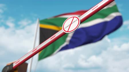 щит : Barrier gate with STOP CORONAVIRUS sign being closed with flag of South Africa as a background. South African quarantine