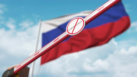 barreira : Barrier gate with STOP CORONAVIRUS sign being closed with flag of Russia as a background. Russian Quarantine