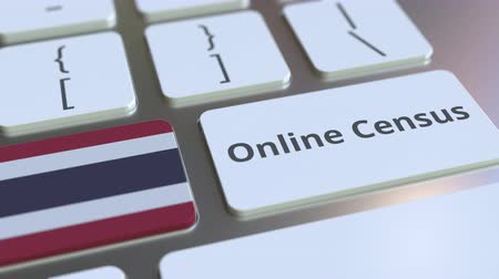 düğmeler : Online Census text and flag of Thailand on the keyboard. Conceptual 3D animation Stok Video