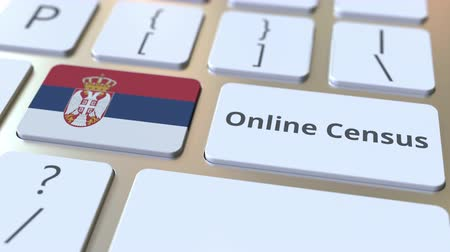 düğmeler : Online Census text and flag of Serbia on the keyboard. Conceptual 3D animation Stok Video