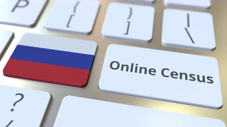 düğmeler : Online Census text and flag of Russia on the keyboard. Conceptual 3D animation Stok Video