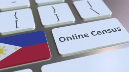 düğmeler : Online Census text and flag of the Philippines on the keyboard. Conceptual 3D animation Stok Video