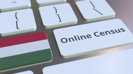 düğmeler : Online Census text and flag of Hungary on the keyboard. Conceptual 3D animation