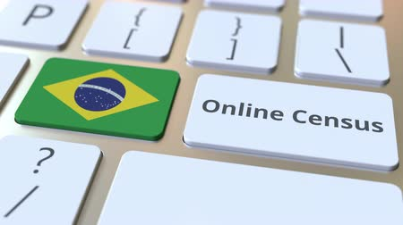 brezilya : Online Census text and flag of Brazil on the keyboard. Conceptual 3D animation Stok Video