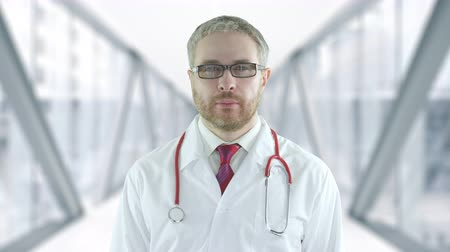 Confident doctor in the modern hospital glass hallway. Shot on Red camera