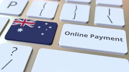 цифровой : Online Payment text and flag of Australia on the keyboard. Modern finance related conceptual 3D animation Стоковые видеозаписи