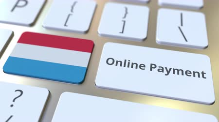 düğmeler : Online Payment text and flag of Luxembourg on the keyboard. Modern finance related conceptual 3D animation